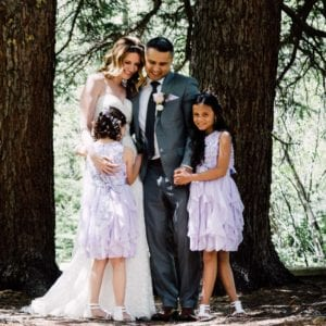 family smiling during outdoor wedding