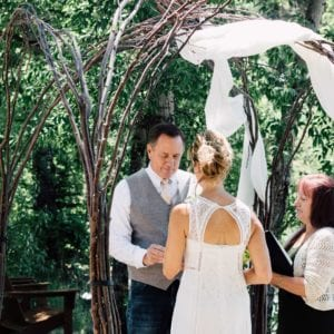 exchanging the rings during outdoor wedding