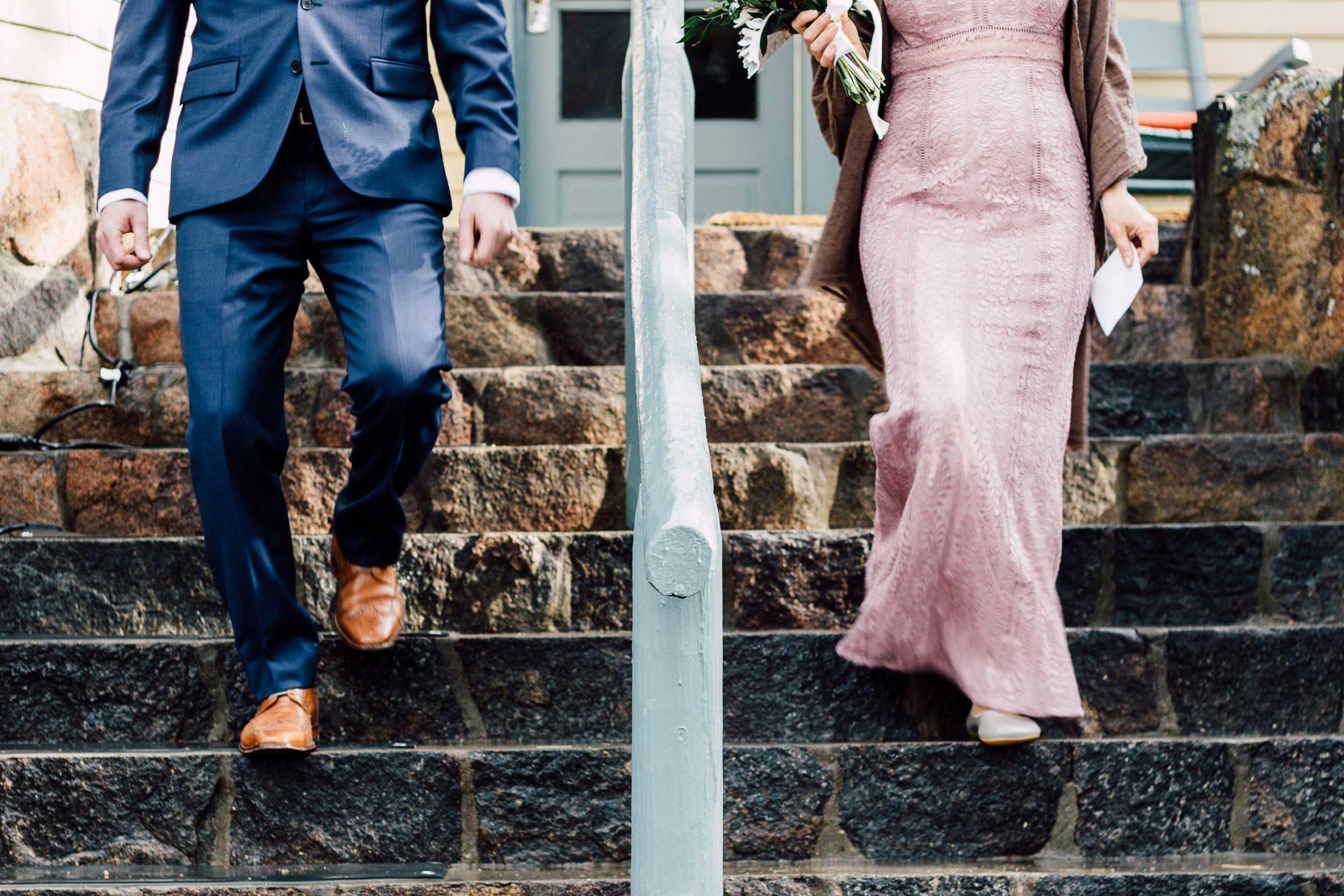 couple walk down steps at RiverSong