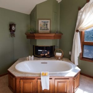 large jetted tub by fire