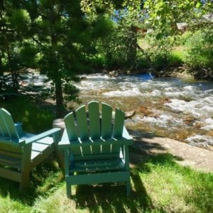 chairs sit by the river