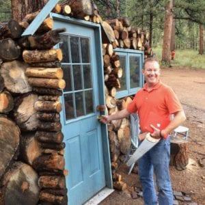 Man smiling by door
