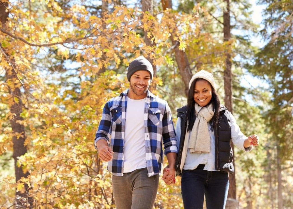 couple walking in woods